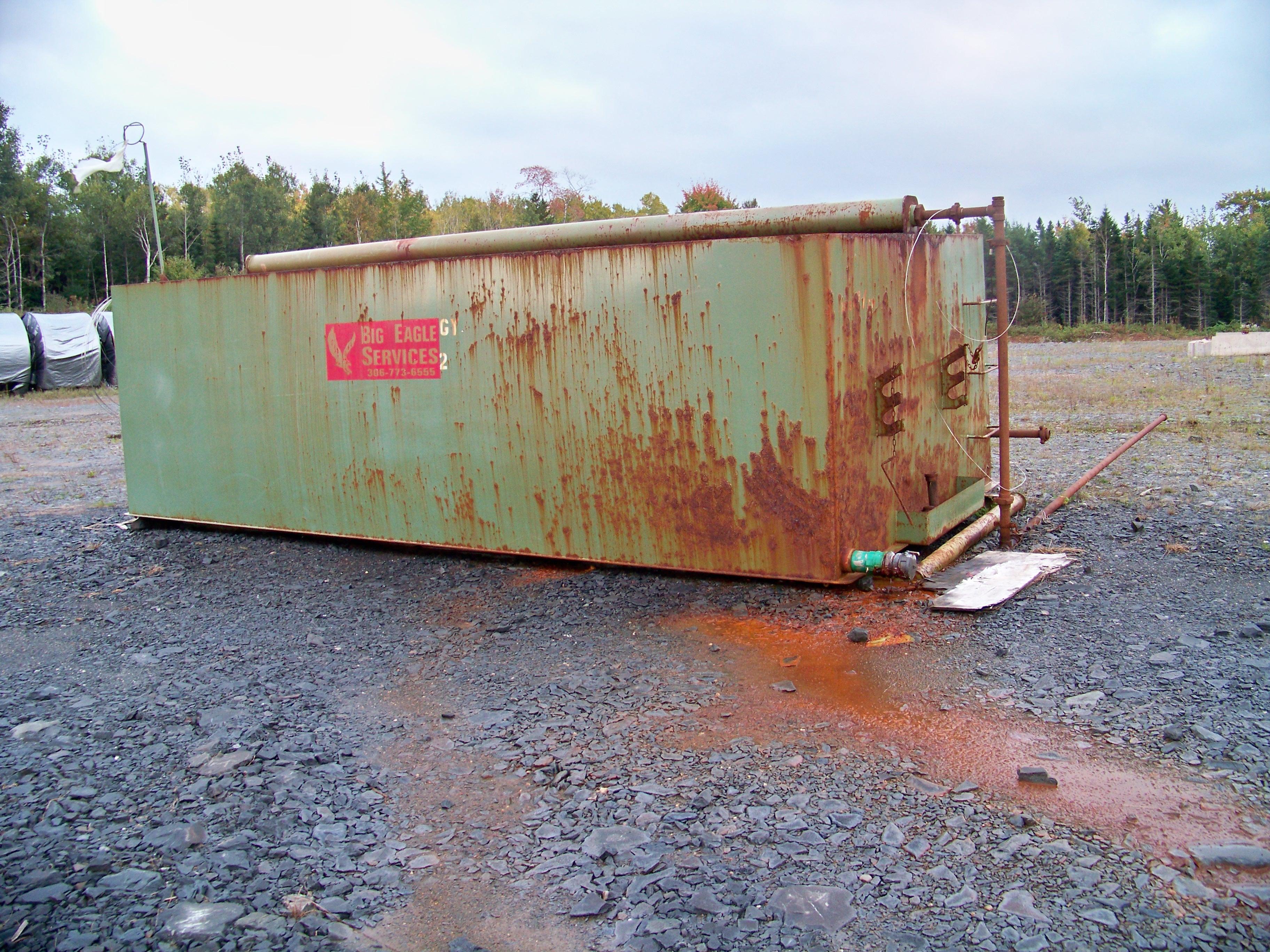 Large open top dumpster of liquid